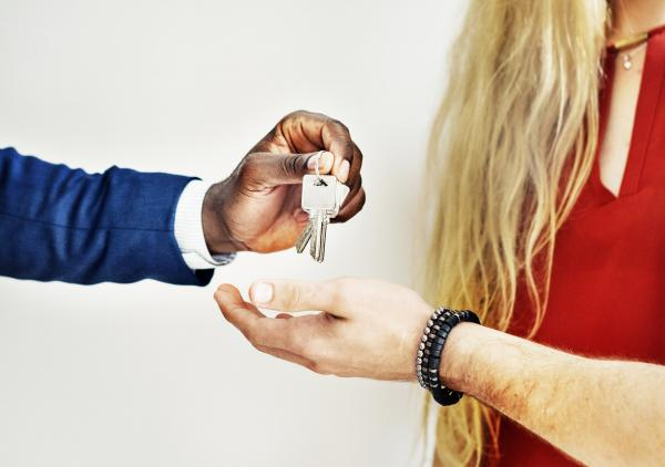 real estate agent giving keys to new homeowners