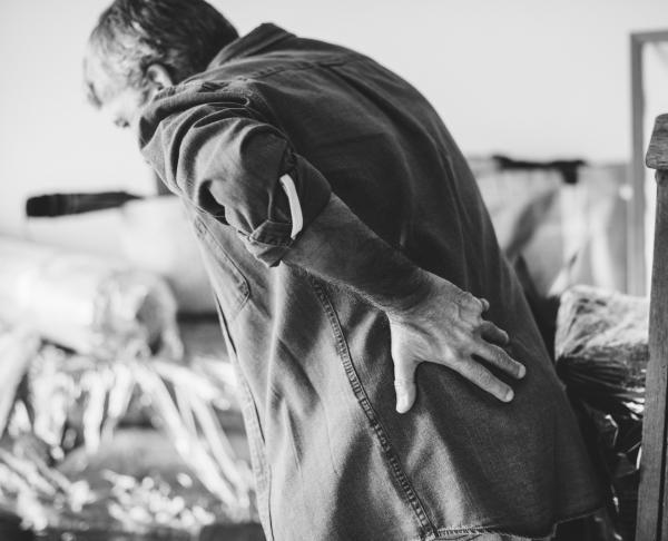 man bent over with back injury